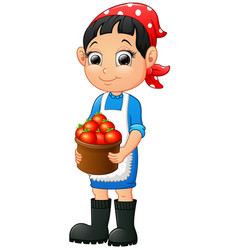 Smiling young woman holding a basket of tomatoes vector