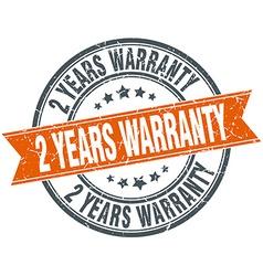 2 years warranty round orange grungy vintage vector