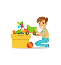 Boy Putting His Toys In Special Box Smiling vector