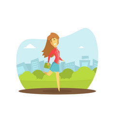 smiling girl with book walking on city street vector image