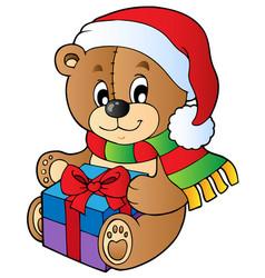 Christmas teddy bear with gift vector