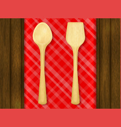 wooden spoon and spatula on red checkered vector image