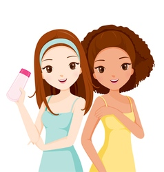 Girls smiling and holding beauty packaging vector