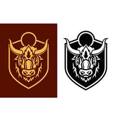 buffalo head sihouettes on shield emblem vector image