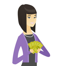 Happy asian business woman holding money vector