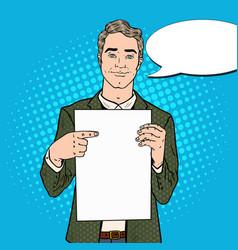 pop art businessman pointing at blank sheet vector image