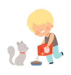 Cute smiling little boy feeding his kitten vector