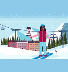 woman taking selfie ski resort hotel houses vector image