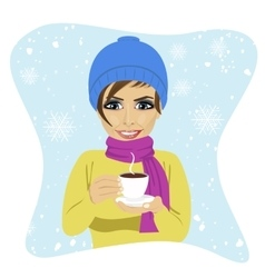 Young woman having cup of hot chocolate in winter vector