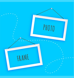 hanging photo frames on blue background vector image