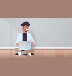 Indian man sitting lotus pose using laptop guy vector