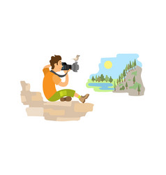 Photographer on rock taking picture landscape vector
