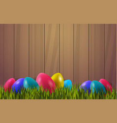 colorful easter eggs on green grass over wooden vector image