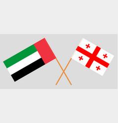 Crossed georgian and uae flags vector