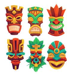 Tiki masks tribal wooden totems in hawaiian style vector