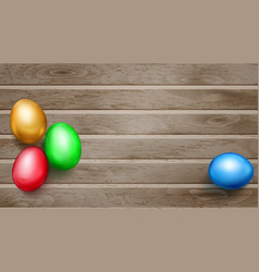 Colored easter eggs on wooden planks vector