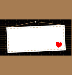 hanging sign with a heart on a brick wall vector image