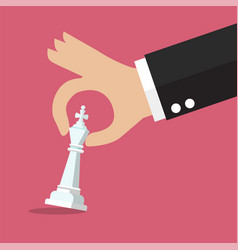 Male hand holding chess figure vector