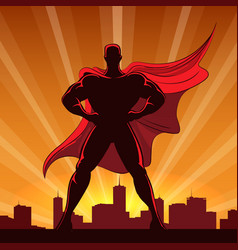 superhero silhouette in red cape vector image