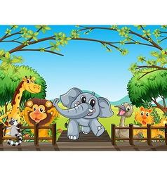 A group of wild animals at the bridge in the vector image