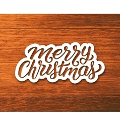 Merry Christmas greetings text on paper label vector image