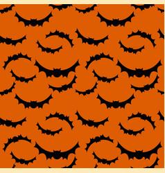 seamless pattern orange background with bat vector image