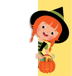 Halloween witch holding a white banner vector image vector image