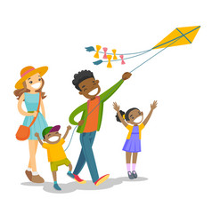 Young multiethnic family playing with a kite vector