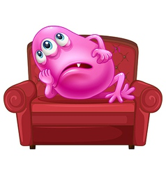 A couch with a pink monster vector image