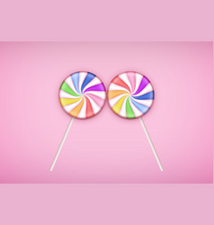Two lolipops candy on pastel pink background vector