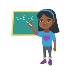 african schoolgirl writing on the blackboard vector image