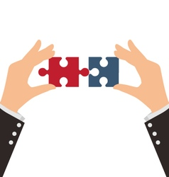Two Business Hands combining two pieces of puzzle vector image