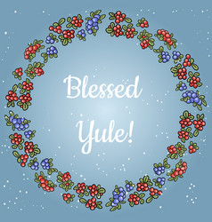 Blessed yule lettering in a wreath of red and blue vector