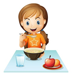 A smiling girl eating her breakfast vector image vector image
