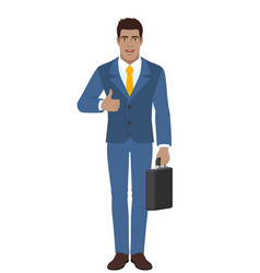 businessman holding briefcase and showing thumb vector image