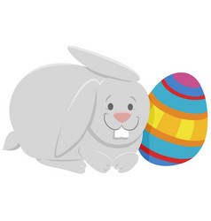 Cartoon easter bunny with colorful easter egg vector