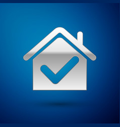 Silver house with check mark icon isolated on blue vector