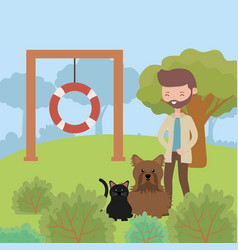 Man with dog and cat in park playing pet care vector