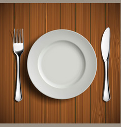 white ceramic plate fork and knife on a wooden vector image