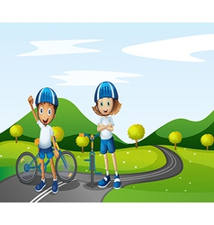 A boy and a girl biking vector image