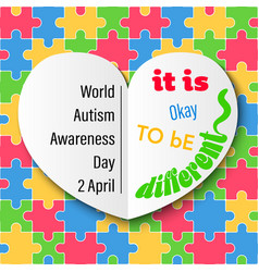 White heart on colorful jigsaw autism day vector