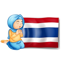 A muslim praying in front of the Thailand flag vector image