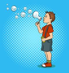child blowing bubbles pop art vector image