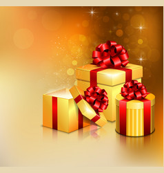 Golden open gift boxes with red bow and ribbon vector