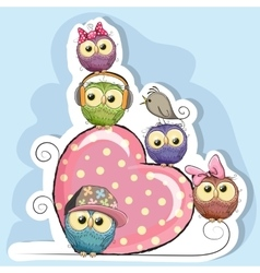 Five Owls is sitting on a heart vector image