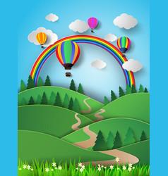 Hot air balloon high in the sky with rainbow vector