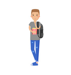boy holding and eating popcorn vector image