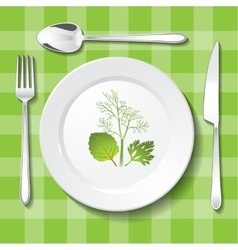 Vegetarian table appointments on green tablecloth vector