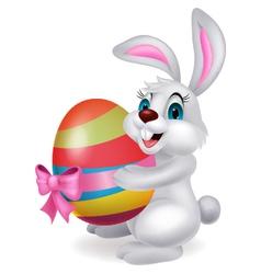 Cute rabbit cartoon holding easter egg vector image