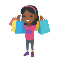 Happy african-american girl holding shopping bags vector